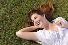 Happy relaxed woman lying on the grass.jpg