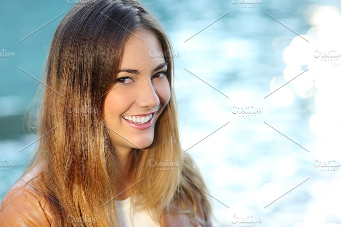 Happy girl with perfect smile and white tooth on the beach.jpg - Beauty & Fashion