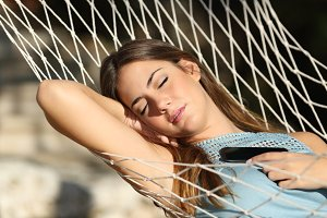 Woman sleeping and resting on a hammock.jpg