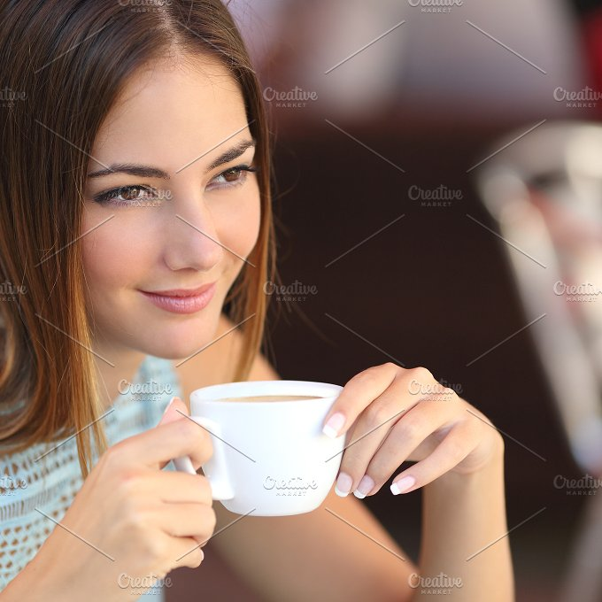 Pensive woman tasting coffee in a restaurant.jpg - Food & Drink