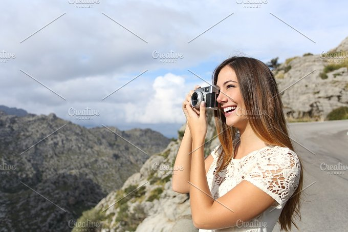 Photographer tourist on vacations taking a photo.jpg - Holidays