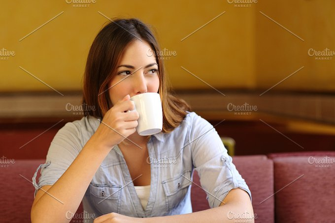 Relaxed woman thinking while is drinking a cup of coffee.jpg - Food & Drink