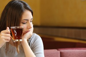 Young woman relaxed in a coffee shop with a cup of tea.jpg