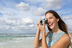Tourist photographer girl taking photo on vacations.jpg