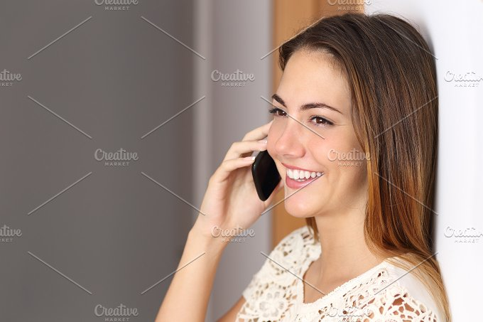 Woman talking on the mobile phone at home or office.jpg - Technology