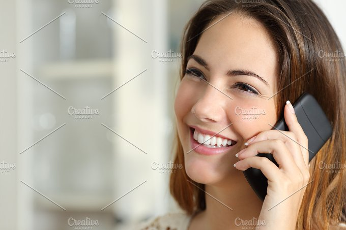 Woman talking on the mobile phone at home.jpg - Technology
