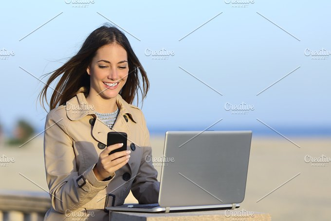Self employed woman working outdoors on the phone.jpg - Technology