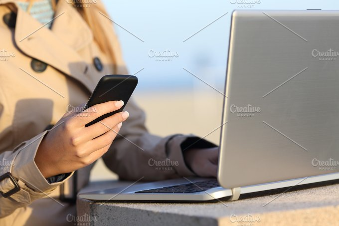 Self employed woman working with a laptop and phone.jpg - Technology
