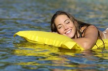 Girl with perfect teeth floating on the beach in summer vacation.jpg