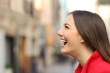 Profile of a woman face laughing happy in the street.jpg