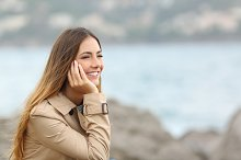 Happy woman thinking and looking away on the sea.jpg