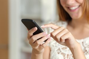 Woman texting on a smart phone at home.jpg