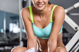 A smiling girl in a fitness club.