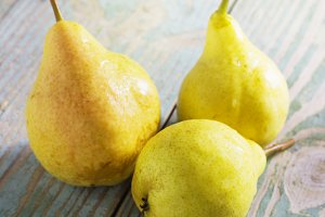 yellow pears on an wooden table