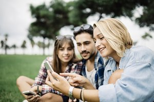 Group of friends using smartphone