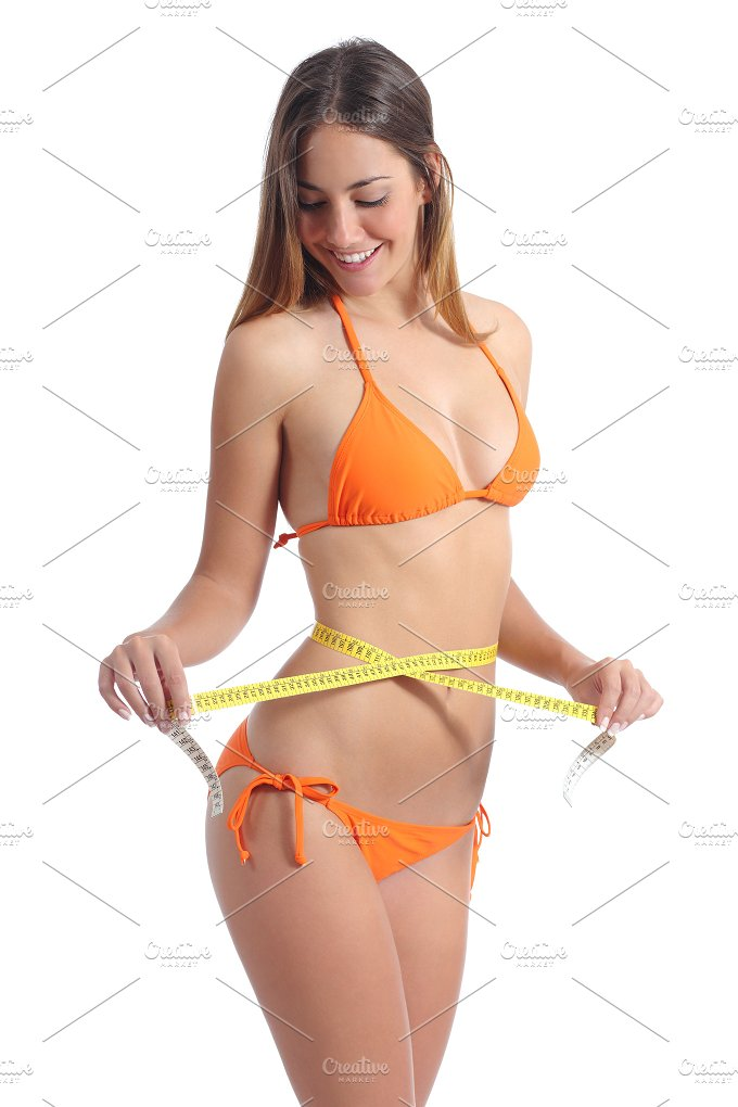 Beautiful girl measuring her waist with a tape measure.jpg - Beauty & Fashion