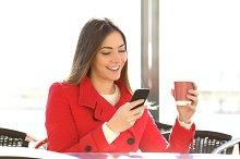 Fashion woman using a smartphone in a coffee shop.jpg