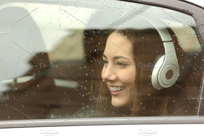 Teenager with headphones listening to the music in a car.jpg - Transportation