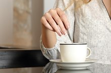 Woman hand preparing a cup of coffee.jpg