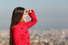 Woman looking forward with city in the background.jpg