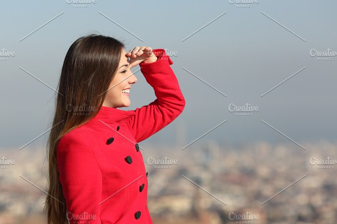 Woman looking forward with city in the background.jpg - People