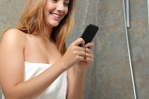 Woman on the phone wasting water in the shower.jpg