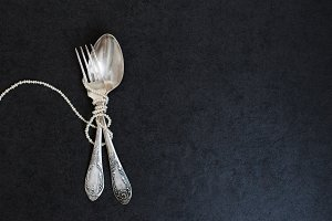 Fork, spoon and pearls
