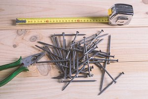 Nails, a measuring tape and pliers