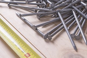 Nails and an extended tape measure