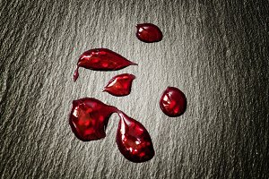 Drops of red raspberry jam