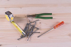 Nails, pliers and screwdriver