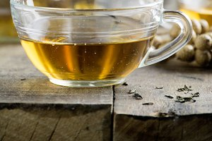 Cup of Healthy Tea over wood backgr