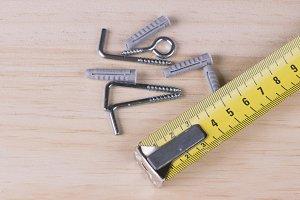 Plugs, screws and tape on wood