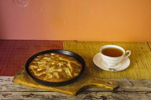 Charlotte. Apple pie with tea