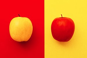 Two apples on bright backgrounds