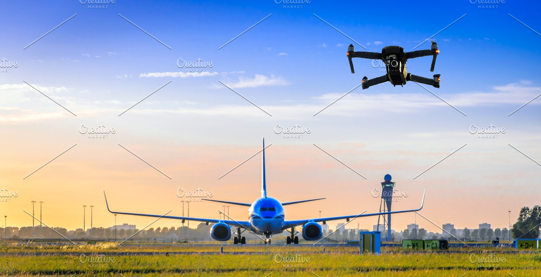 Unmanned drone flying near airplane
