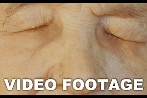 Elderly womans face with tired
