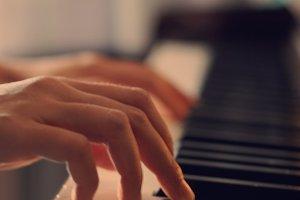 Women's hands plays piano