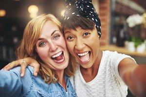 Happy multi ethnic girl friends