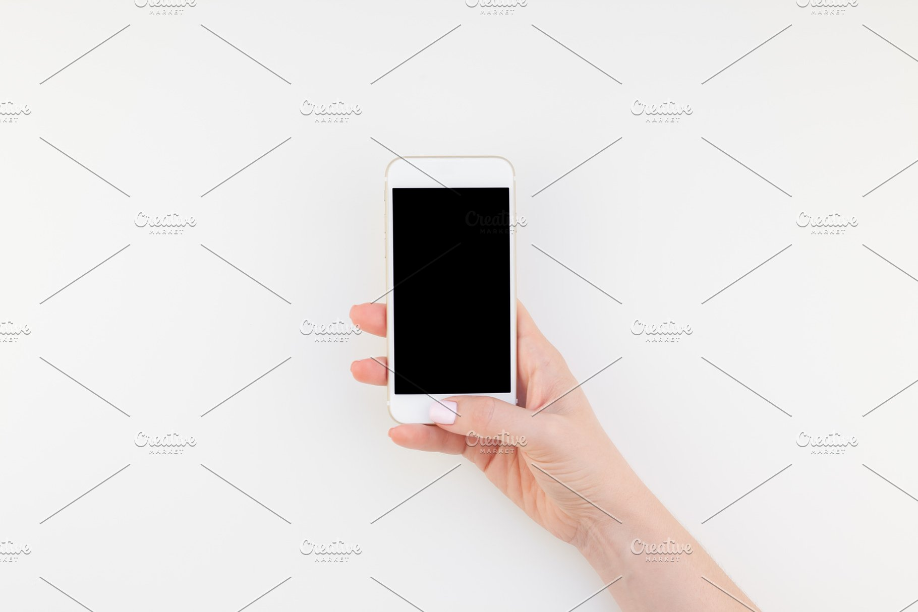 Woman hand with smartphone mock up