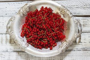 red currants in a metal bowl