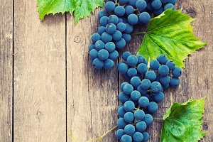 grapes in vintage setting with  on wooden table