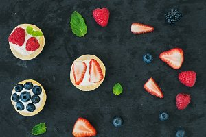 Berry and ricotta tarts with berries