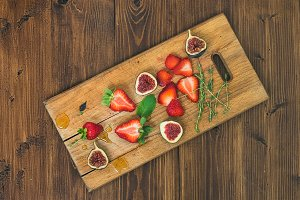 Strawberries, figs and mint leaves