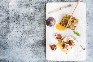 Camembert or brie cheese with figs