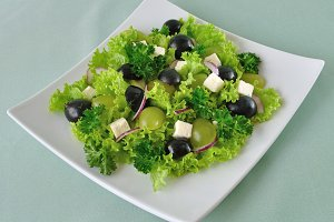 Salad of lettuce , cheese and grapes