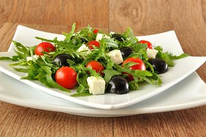 Salad of arugula, tomatoes , grapes