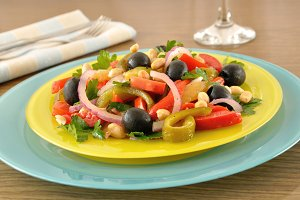 Salad of roasted peppers with tomato