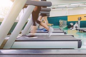 People legs in motion in treadmill
