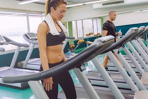 Fitness woman training on treadmill